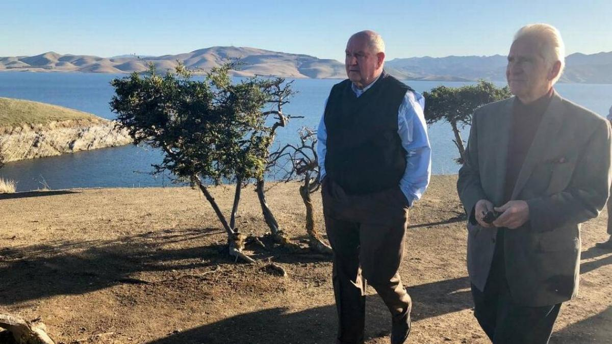 Rep. Jim Costa, D-Fresno, right, shows U.S. Agriculture Secretary Sonny Perdue the San Luis Reservoir earlier this year.